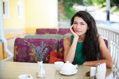 The girl in cafe. The girl sits in cafe and expects the order Stock Images