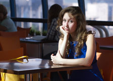 Girl cafe sitting Royalty Free Stock Images