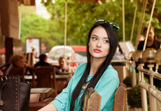 Girl in a cafe waiting Royalty Free Stock Photo
