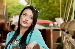 Girl in a cafe waiting Royalty Free Stock Image