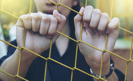 Girl and cage Royalty Free Stock Photography