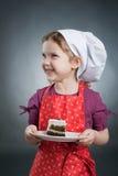 Girl with a cake Stock Photos