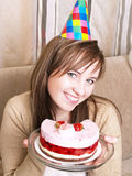 Girl with cake Stock Images