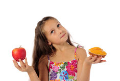 Girl with  cake and  apple Royalty Free Stock Photo