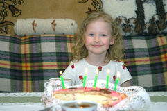 The girl with a cake with candles in honor of birthday. Stock Photo