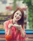Girl with cake and cup Stock Image