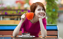 Girl with cake and cup Royalty Free Stock Photo