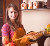 girl with cake in kitchen Royalty Free Stock Photo