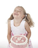 Girl with Cake. Laughing young girl holding cake isolated on whtie Royalty Free Stock Photography