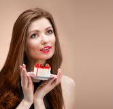 Girl with the cake looking up Stock Images