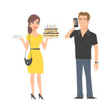 Girl with cake and man with phone Royalty Free Stock Photography