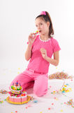 Girl and a cake Royalty Free Stock Photography