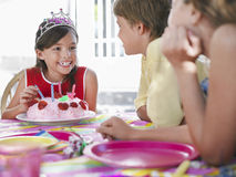 Girl With Cake Talking To Guests At Birthday Party Royalty Free Stock Photography