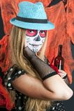Girl with Calavera Mexicana makeup mask in the hat Stock Images