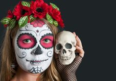 Girl with Calavera Mexicana makeup mask in the hat Stock Photos