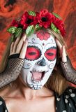 Girl with Calavera Mexicana makeup mask Stock Image