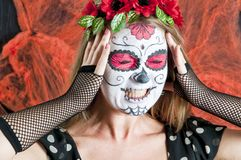 Girl with Calavera Mexicana makeup mask Stock Photos