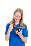 Girl and calculator Royalty Free Stock Photo
