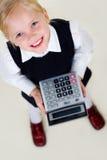 Girl with calculator Royalty Free Stock Photos
