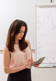 Girl with the calculator. Royalty Free Stock Photo