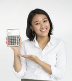 Girl Calculator Business Confident Expression Concept. Asian businesswoman holding calculator commercial Stock Image