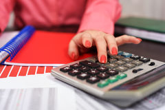 Girl with a calculator Royalty Free Stock Images
