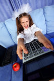 Girl with calculator, laptop Royalty Free Stock Image