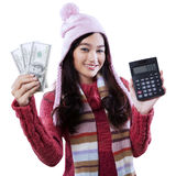 Girl with calculator and money dollars Royalty Free Stock Photography