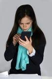 Girl with calculator. Teenager girl   doing  maths school  homework with calculator Royalty Free Stock Photo
