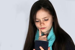 Girl with calculator. Teenager girl   doing  maths school  homework with calculator Royalty Free Stock Photos