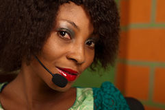 Girl in call center. African American girl in call center stock image