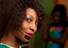 Girl in call center. African American girl in call center stock images