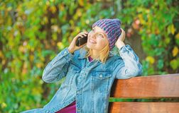 Girl call friend. Stay touch with modern smartphone. Mobile call concept. Girl with smartphone green nature background. Woman having mobile conversation royalty free stock photography