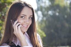 Girl call by  phone and smile Stock Images