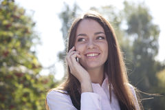 Girl call by  phone and smile Royalty Free Stock Photo