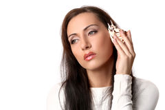 Girl call by shell phone Stock Photography