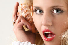 Girl call by shell phone Royalty Free Stock Photos