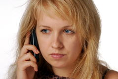 Girl is calling. Blond girl talk to the phone.Isolated photo Stock Image