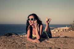 Girl calling a friend Royalty Free Stock Photos