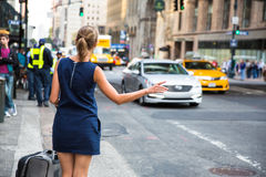 Girl calling/hailking taxi cab on Manhattan Stock Photo