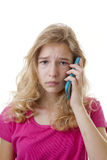 Girl is calling on mobile phone loking sad Royalty Free Stock Images
