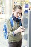 Girl calling parents Stock Image