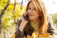 Girl calling by the phone Stock Photography
