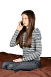 Girl calling by phone. Girl holding a phone to the ear, Girl calling by phone, talking on the phone. isolated on white background. vertical Royalty Free Stock Images