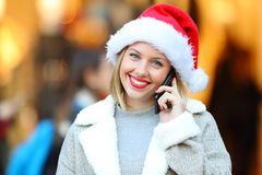 Girl calling on phone in christmas holidays Royalty Free Stock Image