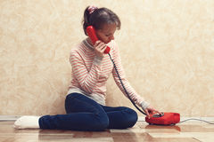 The girl calling by phone Royalty Free Stock Photo