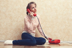 The girl calling by phone Royalty Free Stock Photos
