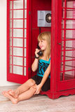 Girl calling in red a phone Stock Photo