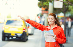 Girl calling taxi cab in New York City Stock Photos