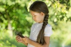 Girl calls. Communication  contact  conversation  cute Stock Photos